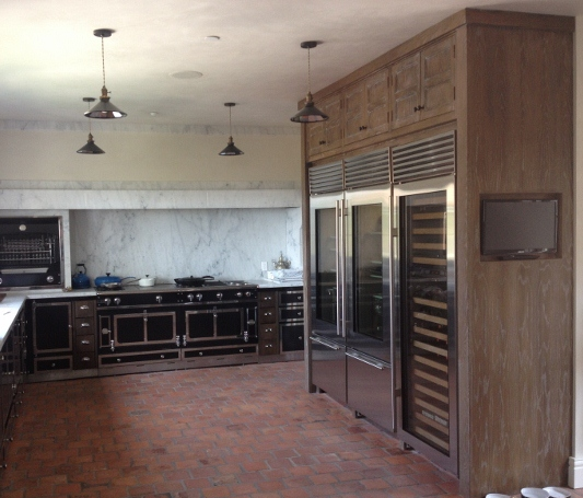 Custom La Cornue Kitchen With White Oak Built In Refrigerator Cabintry